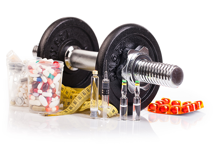 fitness  dumb-bell with drugs isolated on white background