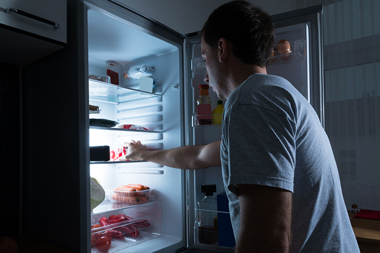 Portrait Of A Man Taking Food From Refrigerator